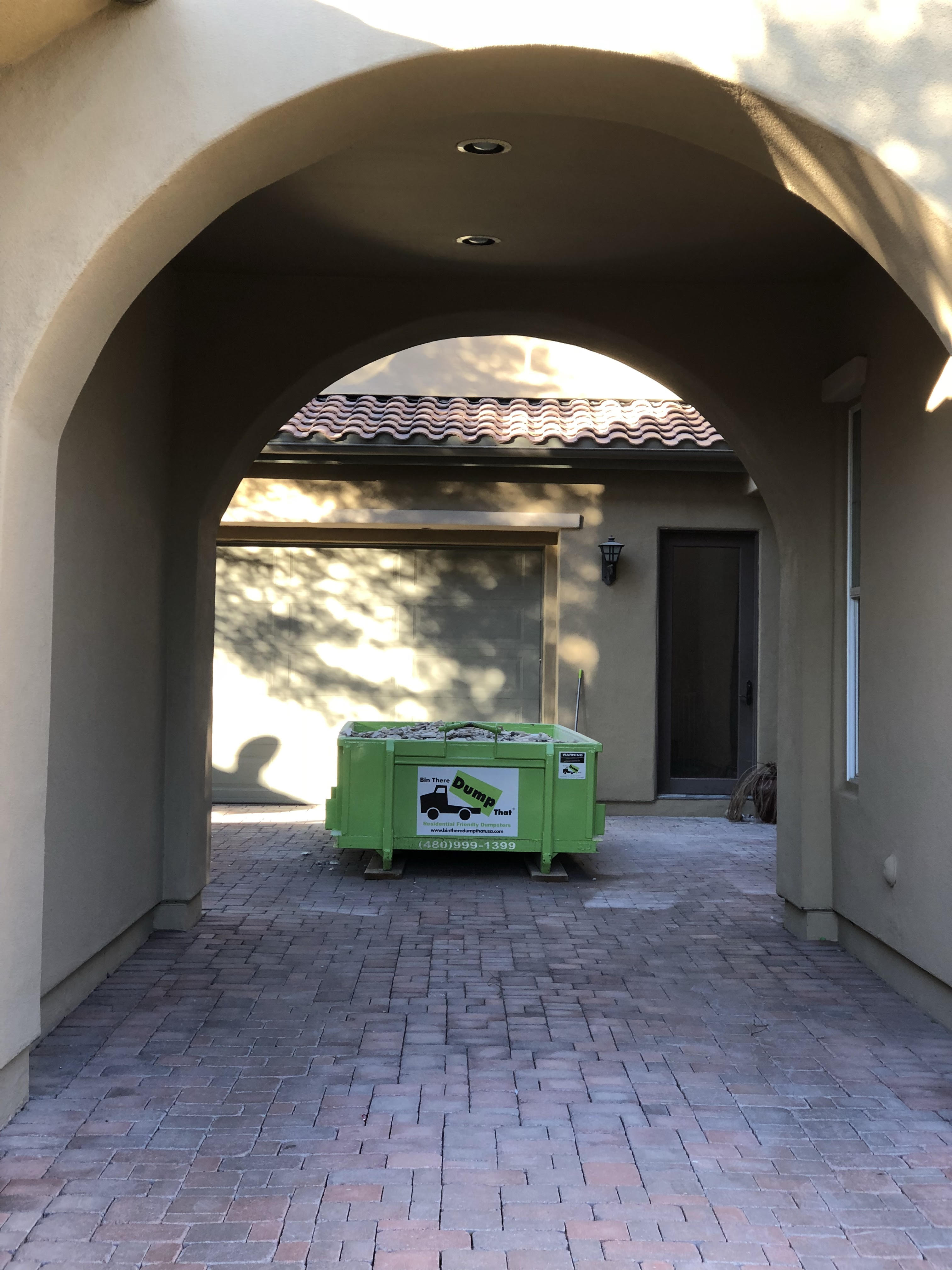 Dumpster Rental on Paver Stone Driveway