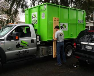Dumpster Delivery Experts Pulling Boards Off Dumps