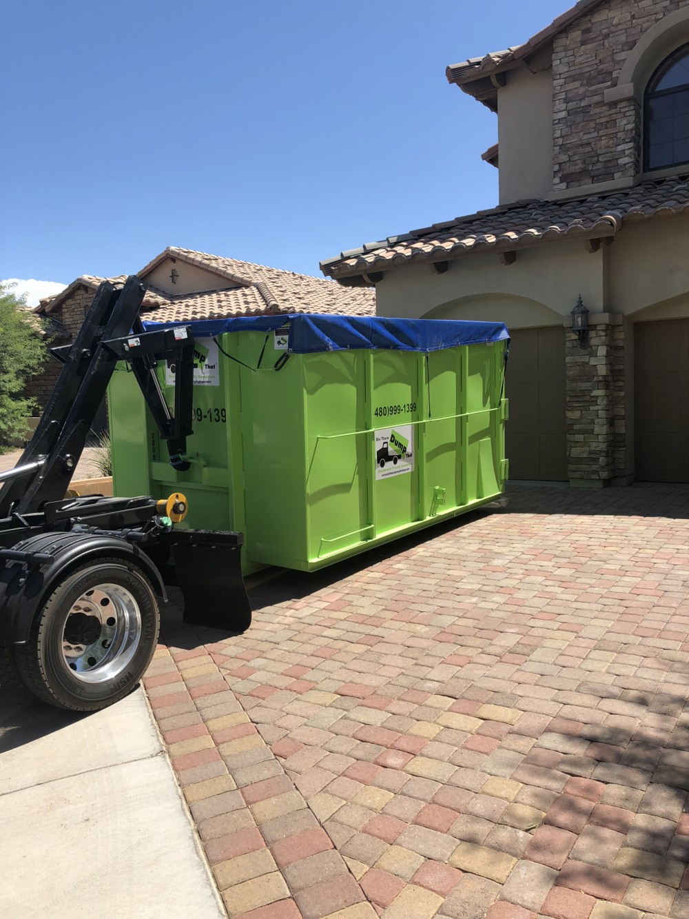 dumpster placed on paver stone driveway in Gilbert