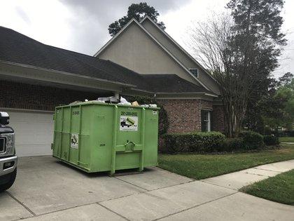 dumpster rental in katy tx driveway
