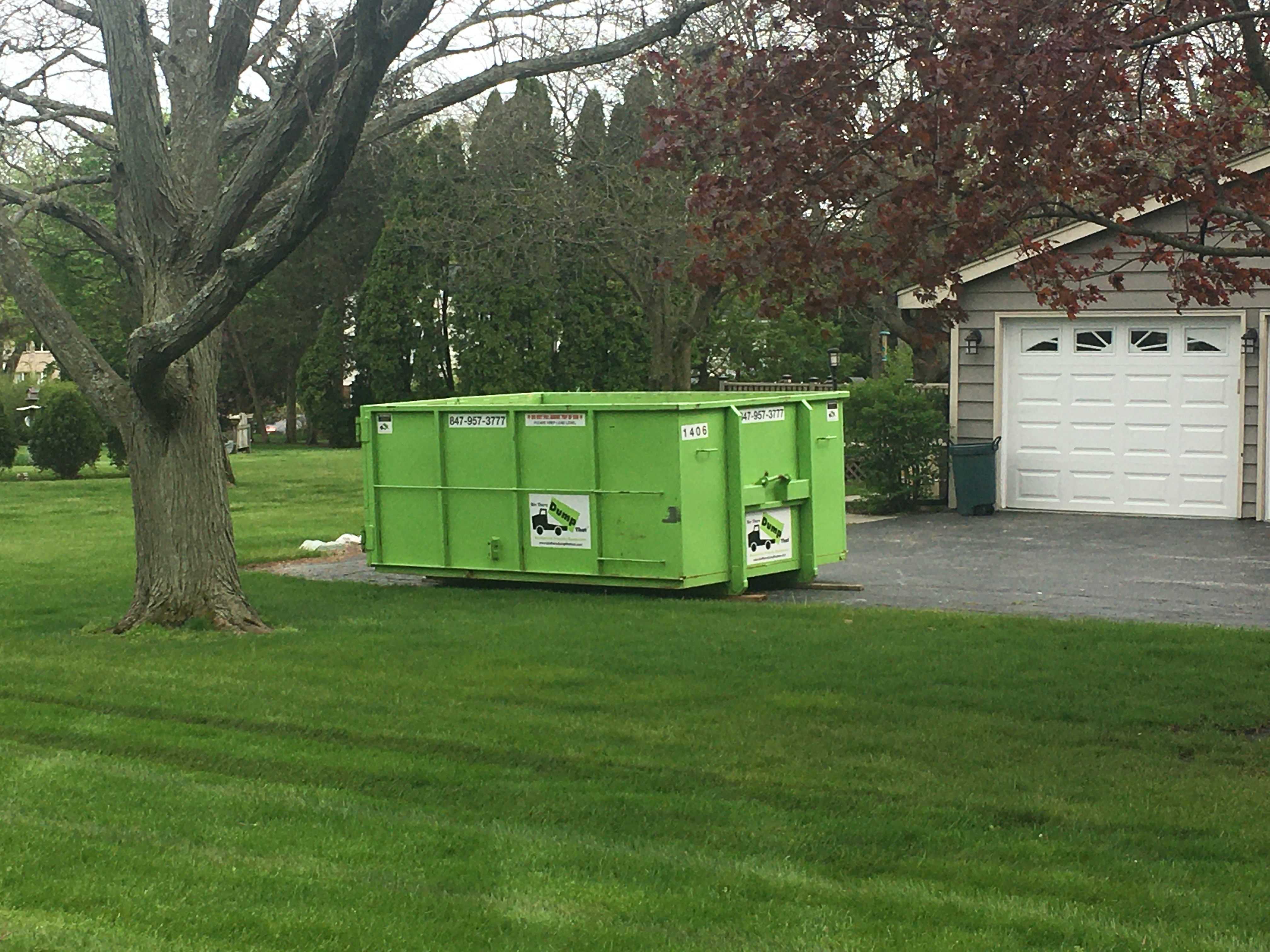 dumpster on driveway protection and tall length doors