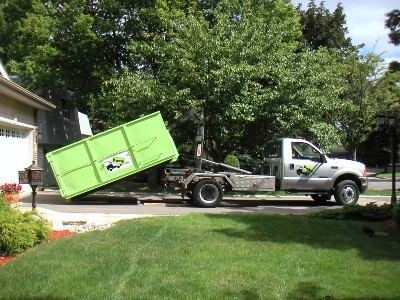 Dumpster Rental and A Truck on A Driveway